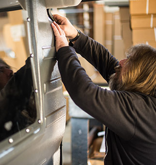 Winston Salem Truck Covers and Accessories Worker Installing